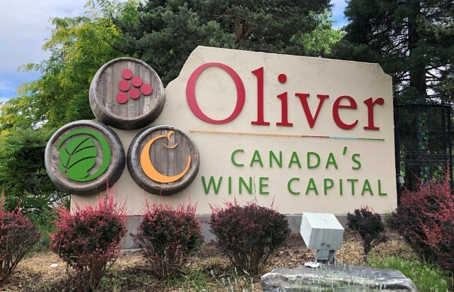 Oliver, British Columbia Sign Canada's Wine Capital with wine barrels