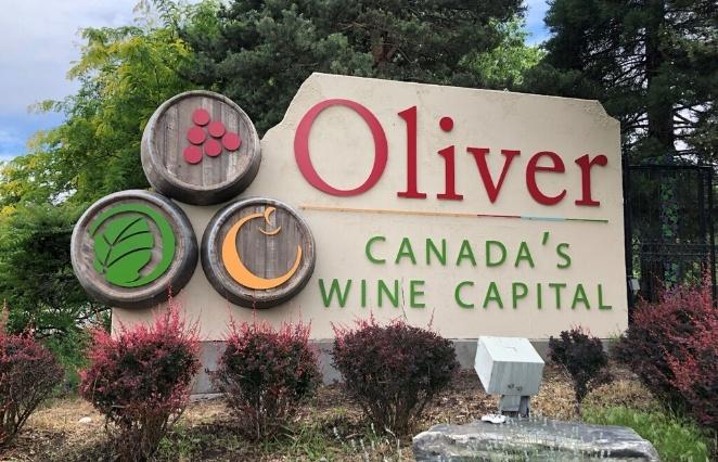 Oliver, British Columbia Sign Canada's Wine Capital with wine barrels